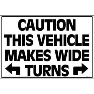 Caution This Vehicle Makes Wide Turns Sign with Arrows