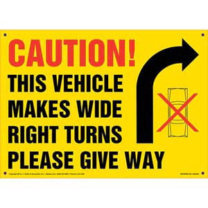 Caution: Vehicle Makes Wide Right Turns Sign